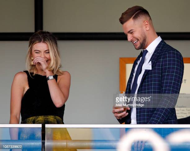 Georgia Toffolo and Chris Hughes watch the racing during the QIPCO British Champions Day at Ascot Racecourse on October 20 2018 in Ascot United...
