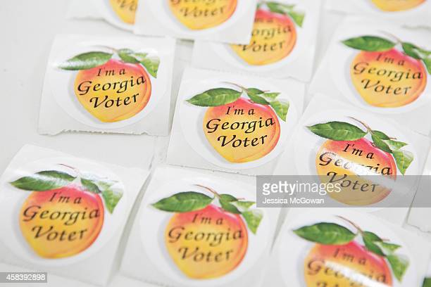 Georgia voter stickers are displayed for voters in the midterm election at Grady High School on November 4 2014 in Atlanta Georgia Georgia Democratic...