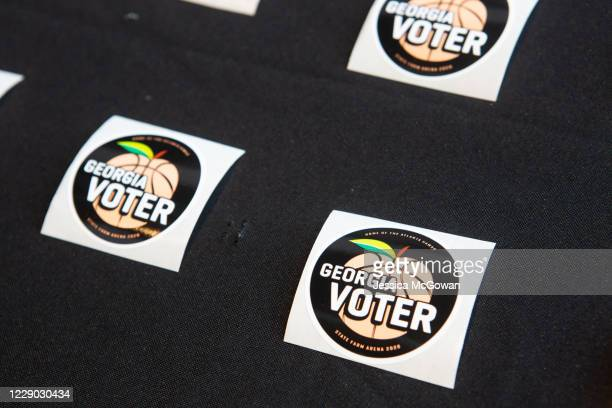 Georgia voter stickers are laid out inside of State Farm Arena, Georgia's largest early voting location, for the first day of early voting in the...