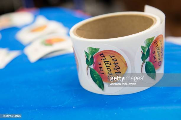Georgia voter stickers lay on a table at CT Martin Natatorium and Recreation Center on October 18 2018 in Atlanta Georgia Early voting started in...