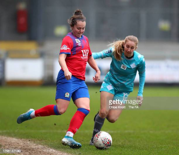 Georgia Walters of Blackburn Ladies looks to break past Grace Neville of London City Lionesses during the Barclays FA Women's Championship match...
