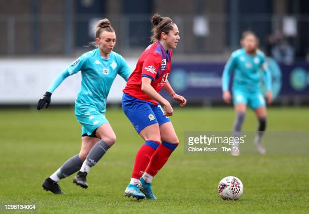 Georgia Walters of Blackburn Ladies looks to break past Poppy Wilson of London City Lionesses during the Barclays FA Women's Championship match...