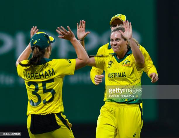 Georgia Wareham and Ashleigh Gardner of Australia celebrate the dismissal of Kycia Knight of West Indies during the ICC Women's World T20 1st...