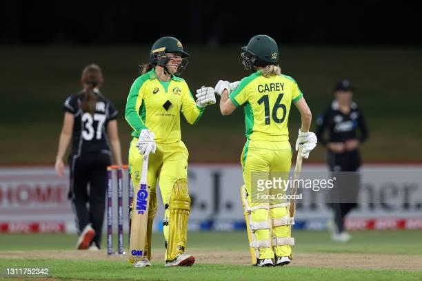 Georgia Wareham of Australia celebrates a boundary with Nicola Carey of Australia during game three of the One Day International series between the...