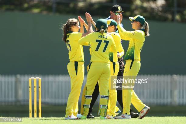 Georgia Wareham of Australia celebrates taking the wicket of Nicole Bolton of Cricket Australia XI during the International Twenty20 warm up match...