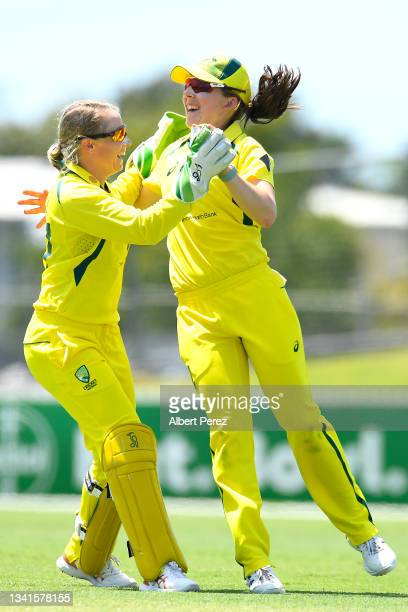 Georgia Wareham of Australia celebrates with Alyssa Healy after catching out Deepti Sharma of India during game one of the Women's One Day...