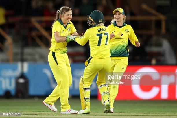 Georgia Wareham of Australia celebrates with Alyssa Healy and Meg Lanning of Australia after taking the wicket of Jess Watkin of New Zealand during...