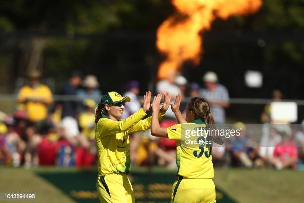 Georgia Wareham of Australia celebrates with Meg Lanning after dismissing Katey Martin of New Zealand during game two of the Women's International...