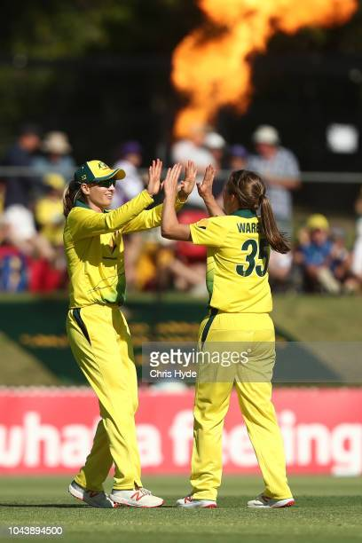 Georgia Wareham of Australia celebrates with Meg Lanning after dismissing Katey Martin of New Zealand during game two of the Women's International...