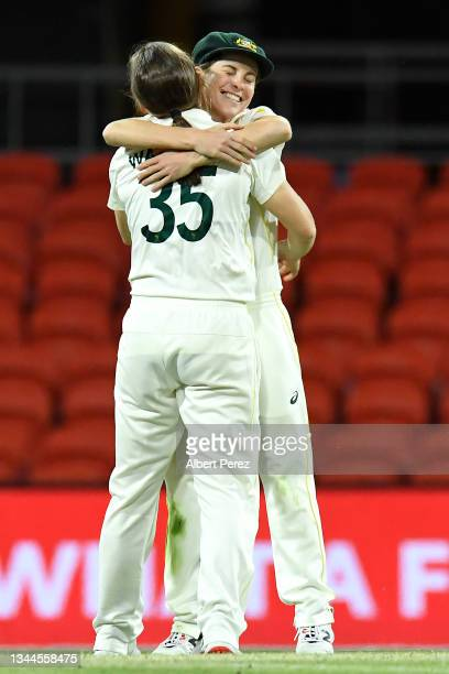 Georgia Wareham of Australia celebrates with Sophie Molineux after dismissing Shafali Verma of India during day four of the Women's International...