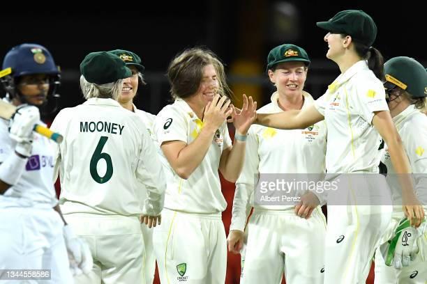 Georgia Wareham of Australia celebrates with team mates after dismissing Shafali Verma of Australia during day four of the Women's International Test...