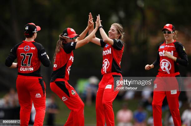Georgia Wareham of the Renegades is congratulated by her teammates after dismissing Deandra Dottin of the Heat during the Women's Big Bash League...