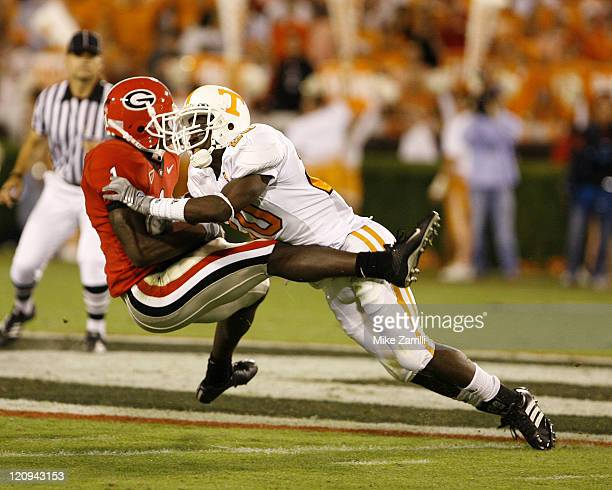 Georgia WR Mohamed Massaquoi is tackled by UT DB Demetrice Morley during the game between the Georgia Bulldogs and the Tennessee Volunteers at...