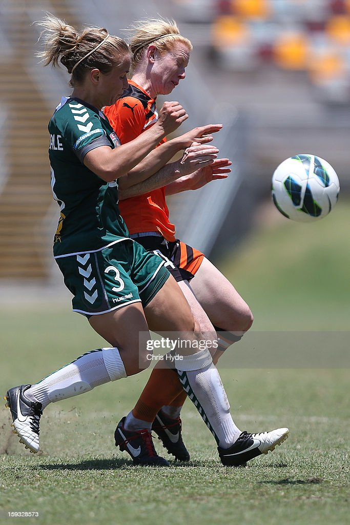 Georgia Yeoman-Dale of United and Clare Polkinhorne of the Roar compete for the ball during the round 12 W-League match between the Brisbane Roar and Canberra United at Queensland Sport and Athletics Centre on January 12, 2013 in Brisbane, Australia.