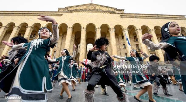Georgian children dance during a rally to commemorate the 30th anniversary of the socalled 'Tbilisi tragedy' as they mark the Day of National Unity...