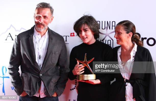 Georgian film director Ana Urushadze poses with her Golden Star for Best Feature Narrative Film award next to actor Dimitri Tatishvili and actress...