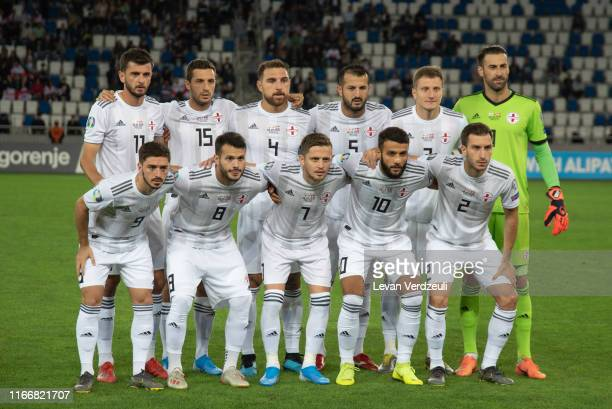 Georgian national team poses for the team photo during the 2020 UEFA European Championships group D qualifying match between Georgia and Denmark at...