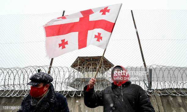 Georgian opposition supporters take part in a rally following the arrest of the leader of the United National Movement Nika Melia near a prison in...