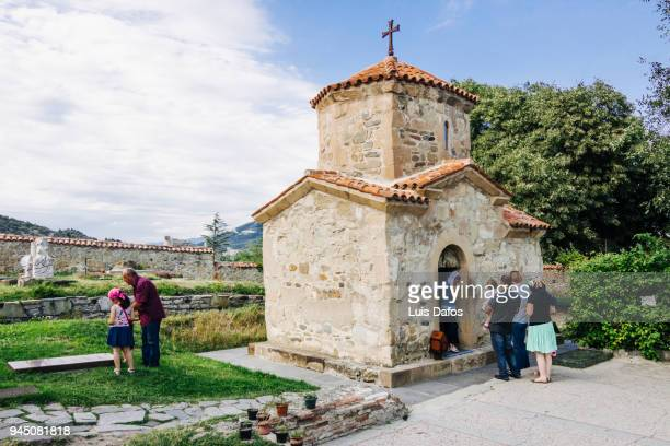 Georgian people visiting a chapel in Samtavro Monastery