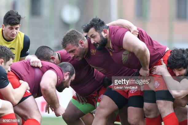 Georgian players prepare for scrum during the Georgian rugby national team training session at Shevardeni rugby stadium on March 8, 2018 in Tbilisi,...