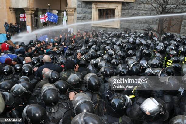 Georgian police officers intervene in demonstrators with water cannon, in Tbilisi, Georgia on November 18, 2019. Demonstrators gathered in front of...