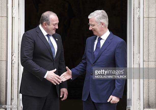 Georgian President Giorgi Margvelashvili shakes hands with Belgium King Philippe - Filip during a meeting at the Royal Palace in Brussels on May 12,...