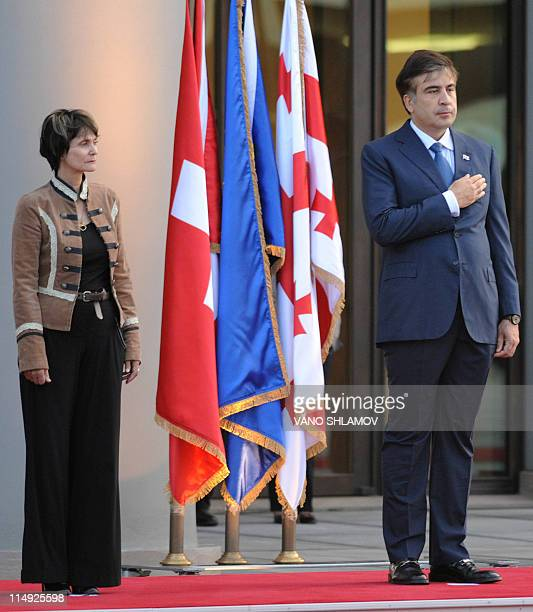 Georgian President Mikheil Saakashvili and his Swiss counterpart Micheline CalmyRey attend an official welcome ceremony in Tbilisi on May 29 2011 The...