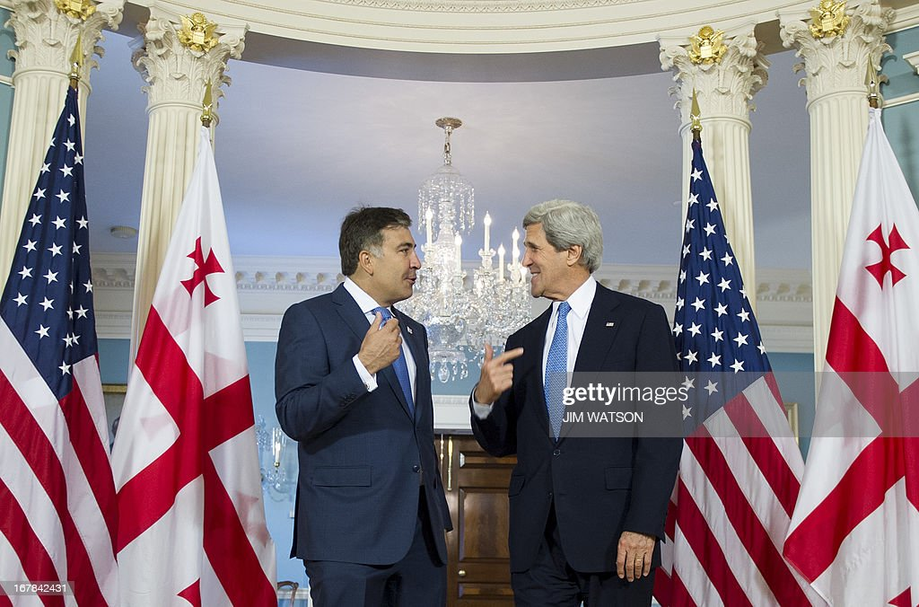 Georgian President Mikheil Saakashvili delivers a statement with US Secretary of State John Kerry at the State Department in Washington, DC, on May 1, 2013.