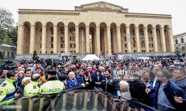 Georgian President Salome Zurabishvili and Georgian Orthodox Patriarch Ilia II take part in a rally to commemorate the 30th anniversary of the...