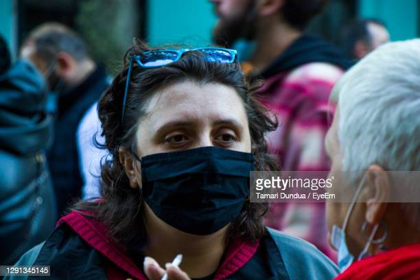 georgian protests in front of the parliament of georgia, people with medical face masks. - campaigner stock pictures, royalty-free photos & images