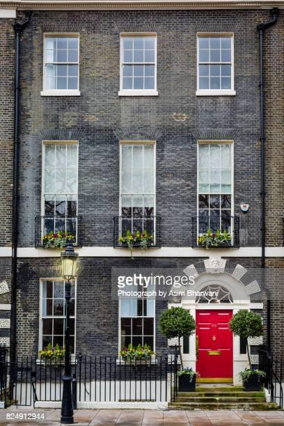 georgian red door - bloomsbury london stock photos and pictures