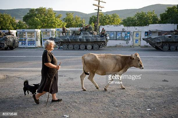 Georgian resident of Igoleti walks past Russian military vehicles as the tense standoff on the north of Georgia continued on August 15 2008 in...