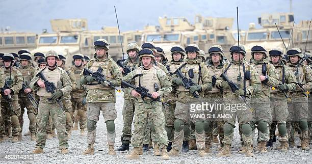 Georgian servicemen stand at attention after a military drill at a base near the town of Gardabani south of Tbilisi on January 23 2015 According to...