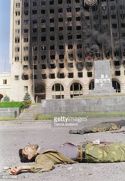 Georgian soldier killed during the battle for Sukhumi lay in front of the burning parliament building in Sukhumi 28 September 1993 The Abkhazian...
