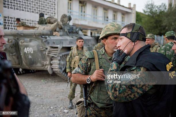 Georgian soldiers and police stand next to Russian armour as the tense standoff on the north of Georgia continued on August 15 2008 in Igoleti...