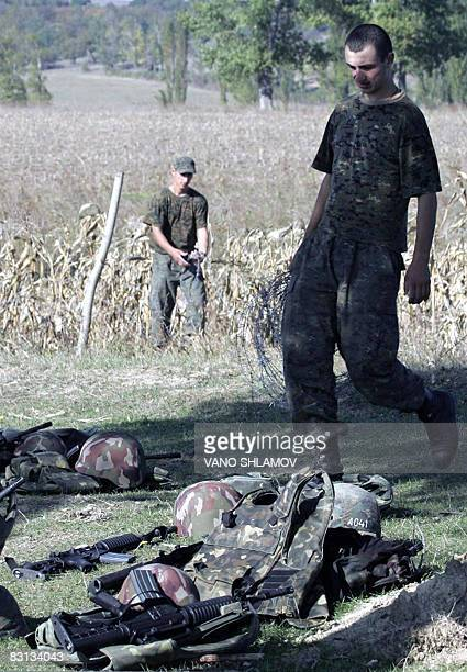 Georgian soldiers remove barbed wire on the site of a former Russian installation not far from the village of Nabakhtevi 120 kilometers from Tbilisi...