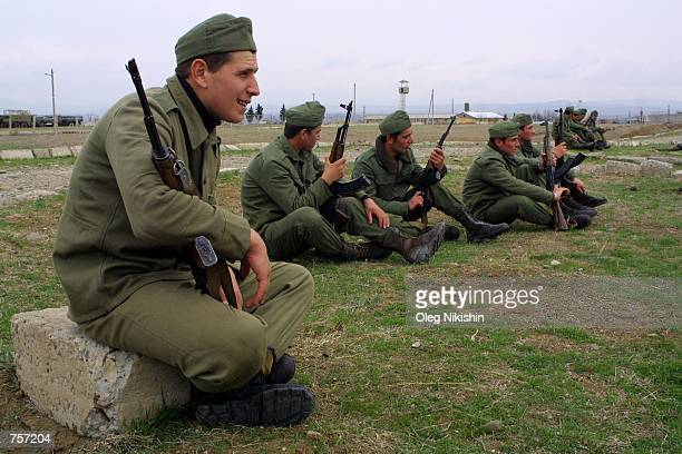 Georgian soldiers rest after training at a military base April 5 2002 near Tbilisi Georgia Approximately 200 US instructors are expected to arrive in...