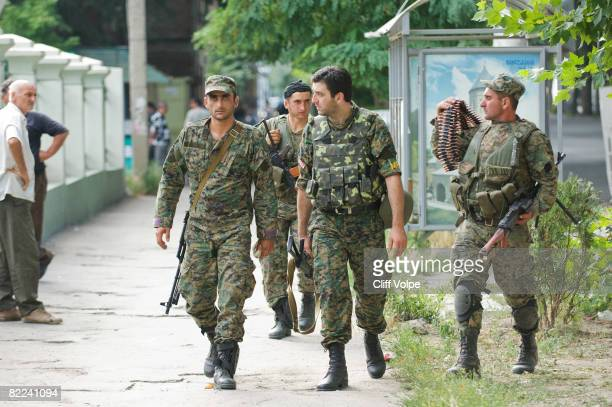 Georgian soldiers return to Gori after fighting in South Ossetia on August 10 2008 in Gori Georgia After calling a ceasefire Georgian forces have...
