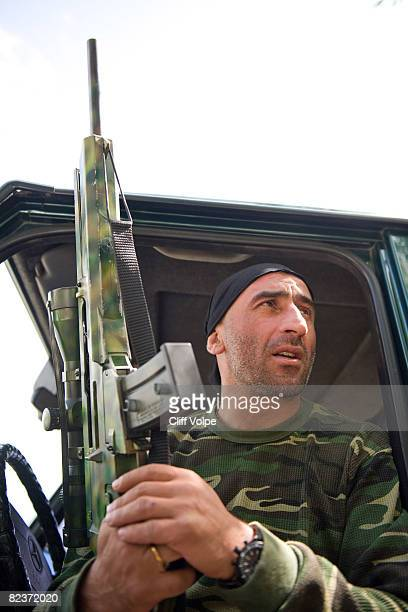 Georgian special forces soldier holds a Germanmade Heckler and Koch SL8 sniper rifle on the road between Gori and Tbilisi August 15 2008 outside Gori...