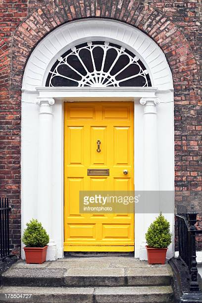 georgian style yellow wooden door - door knocker stock photos and pictures
