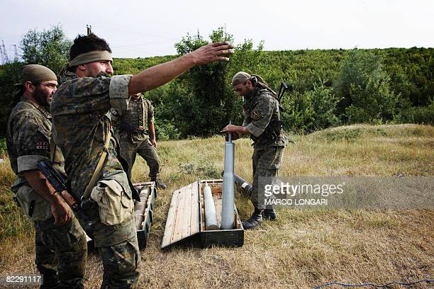 Georgian troops arrange artillery ammunition on August 13 2008 while positioned 45km from the capital Tibilisi Several dozen elite Georgian soldiers...