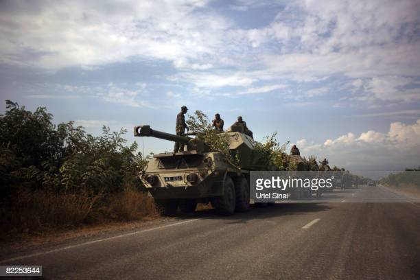 Georgian troops on the road between Tskinvali and Gori 20 km from the South Ossetian border on August 2008 near Gori Georgia After calling a...
