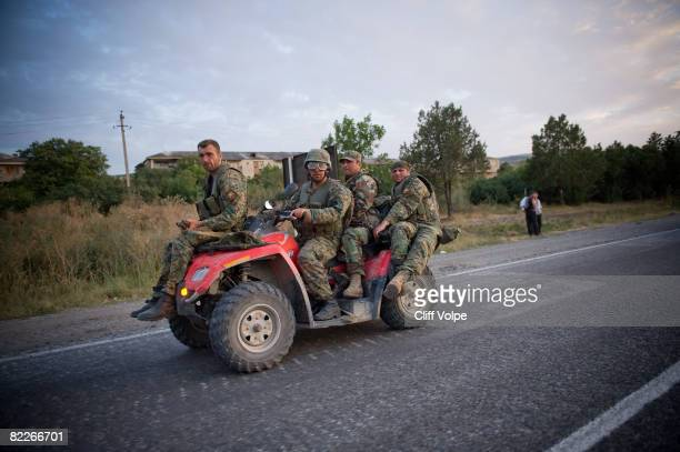 Georgian troops rush to evacuate from Gori along the highway towards Tbilisi on August 11 2008 near Gori Georgia Georgian troops are withdrawing to...