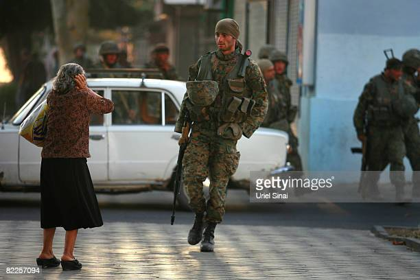 A Georgian woman holds her head as Georgian soldiers head towards Tbilisi on August 11 2008 in Gori Georgia Russia called today for Georgian forces...