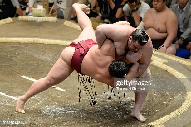 Georgian wrestler Gagamaru throws Endo to win during day one of the Grand Sumo Summer Tournament at Ryogoku Kokugikan on May 8 2016 in Tokyo Japan