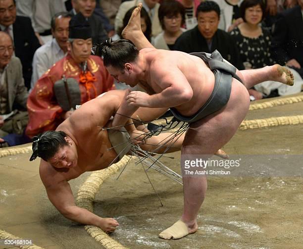 Georgian wrestler Tochinoshin throws Mongolian wrestler Takanoiwa to win during day three of the Grand Sumo Summer Tournament at Ryogoku Kokugikan on...