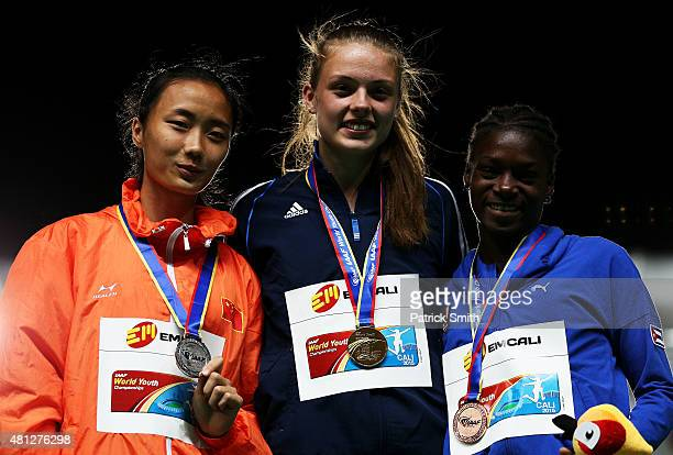 Georgiana Iuliana Anitei of Romania gold medal Rui Zeng of China silver medal and Yanna Anay Armenteros of Cuba bronze medal celebrate on the podium...