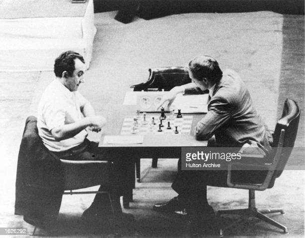 Georgianborn Soviet Chess champ Tigran Petrosian and Bobby Fischer of the United States faceoff during their world chess championship semifinal...