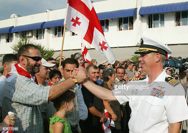 Georgians greet captain John Moore of the USS Mount Whitney destroyer in Poti on September 5 2008 The US State Department rejected Russian criticism...