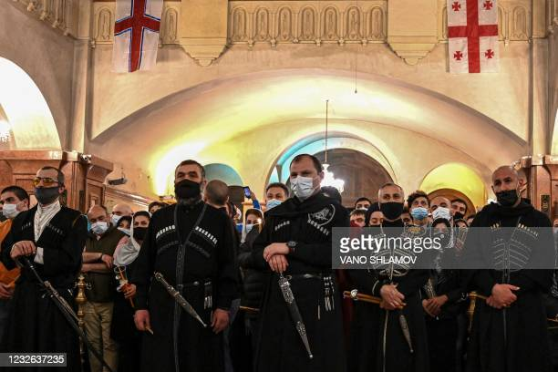 Georgians wearing traditional costumes attend an Orthodox Easter service at Sameba temple church in Tbilisi on May 2, 2021.
